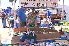 Kids-Build-a-Boat-in-action painting sections of boat