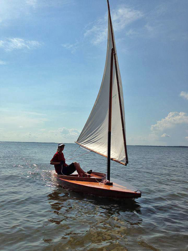 "Audrey Lewis sails ""Zip"", a 1953 Sunfish Sailboat"